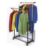 Garment rack with clothes on hangers