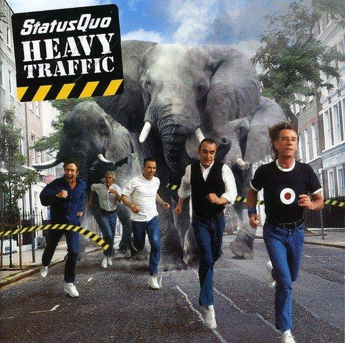 Status Quo - Heavy Traffic - Zortam Music